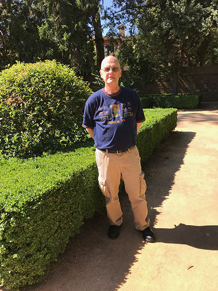 Steven R. Brown stands in the gardens of the Hotel Paradore de Granada, adjoining the Alhambra Palace. While in Granada, he presented a paper at an international conference.