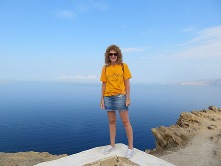 Molly Sergi, Ph.D., professor of history at Kent State University at Geauga, visited Greece while doing some research in Europe. Dr. Sergi proudly dons a Kent State T-shirt.