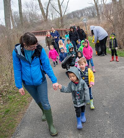 Child Development Center kindergartners walking outside